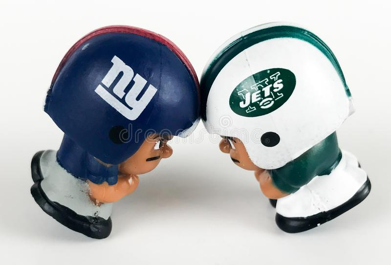 Giants and Jets go helmet to helmet. Two Li`l Teammates toy figures on a white backdrop stock photography