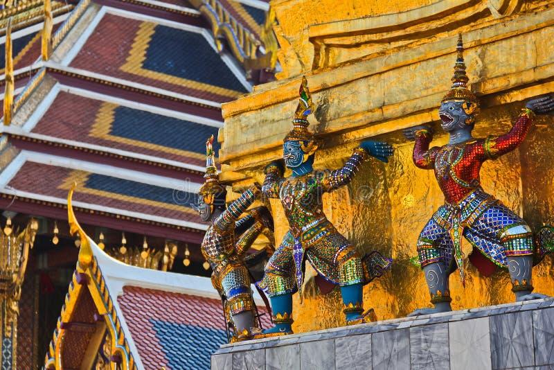 Giants and monkeys hand to lift golden pagoda stock images