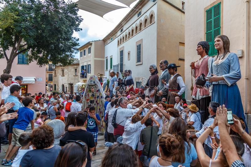 The giants parade in Alcudia. The giants parade during the Fira d`Alcudia is a highlight for tourists and locals alike. The giants only come out once a year and