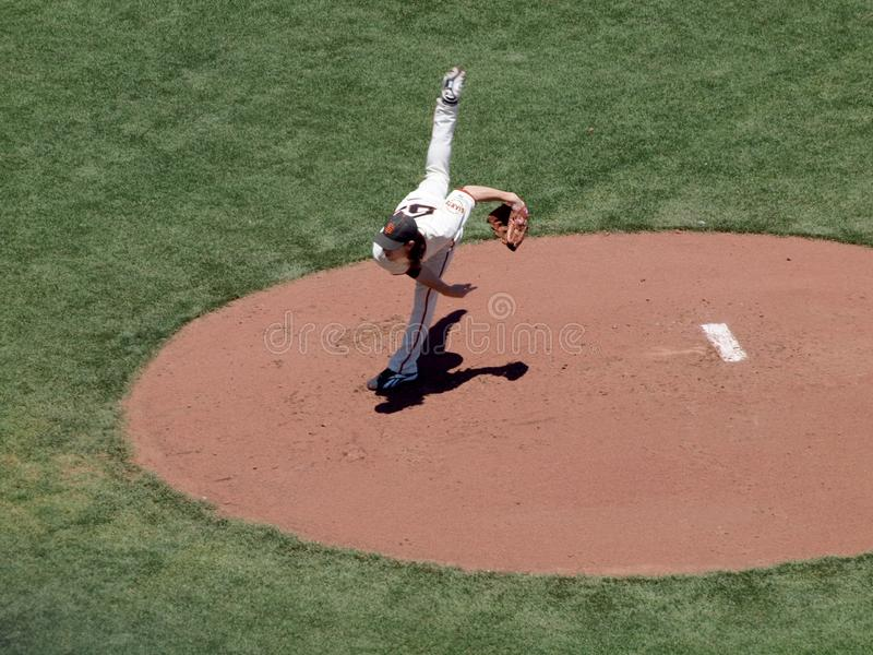 Giants two time Cy Young award winner Tim Lincecum finishes throwing a pitch by lifting back leg high into the air stock photos