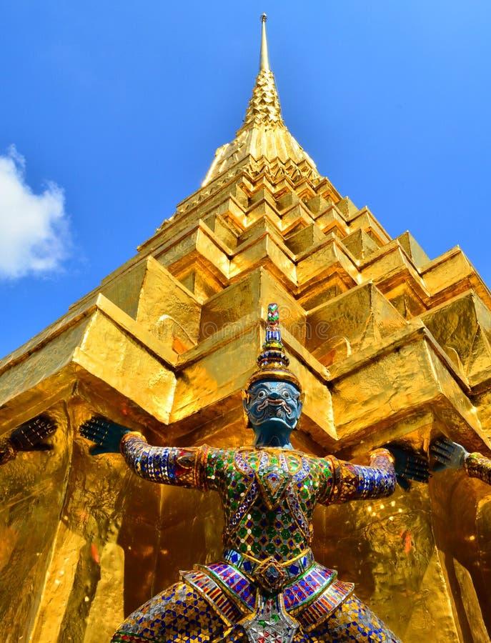 Giants under golden pagoda stock photo