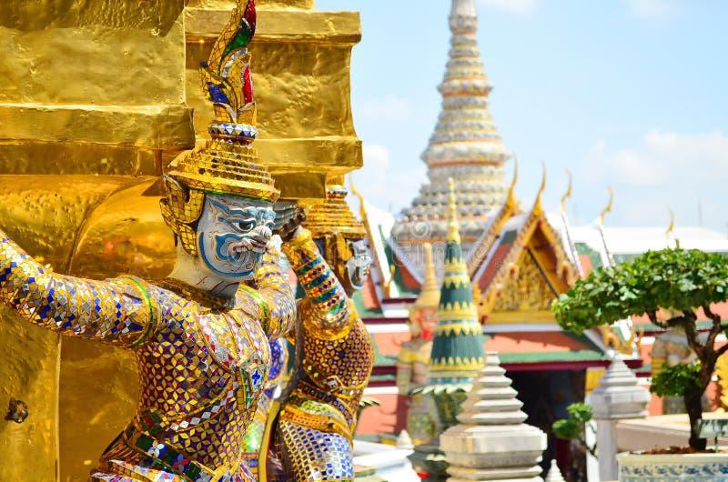 Giants under golden pagoda stock image