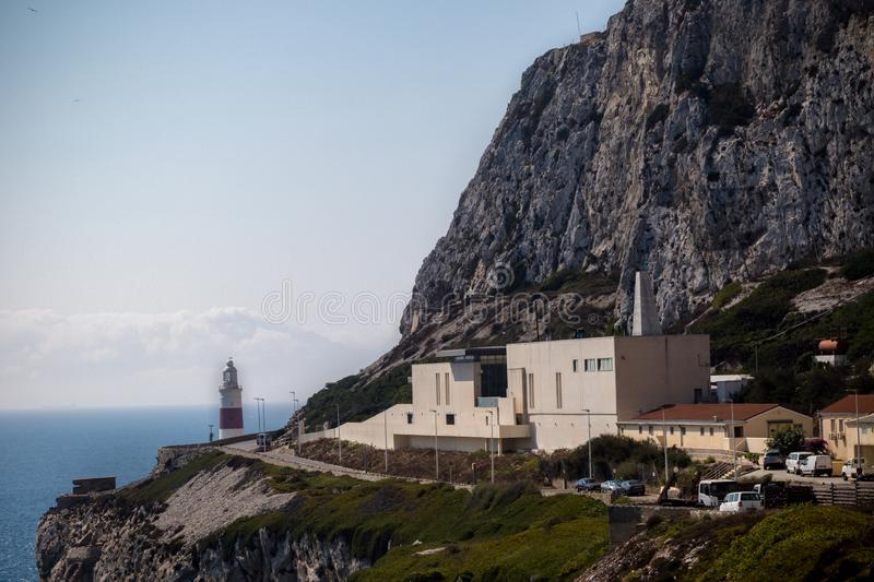 Gibraltar crematorium East side of the Rock. Gibraltar, United Kingdom, 2nd October 2018:-Gibraltar crematorium with Europa Point lighthouse in the background stock photography