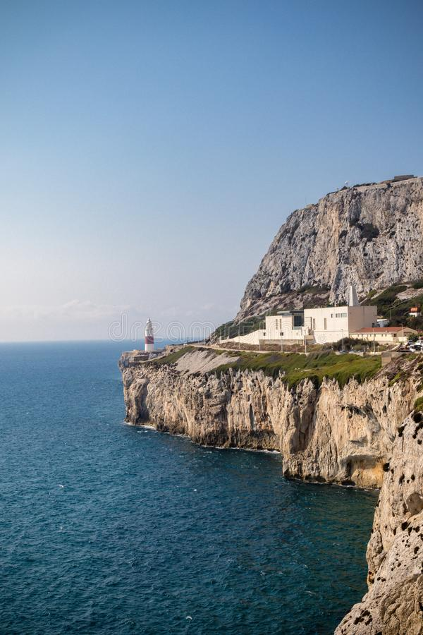 Gibraltar crematorium East side of the Rock. Gibraltar, United Kingdom, 2nd October 2018:-Gibraltar crematorium with Europa Point lighthouse in the background royalty free stock images