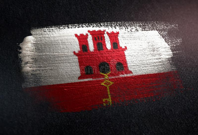 Gibraltar Flag Made of Metallic Brush Paint on Grunge Dark Wall royalty free stock photography