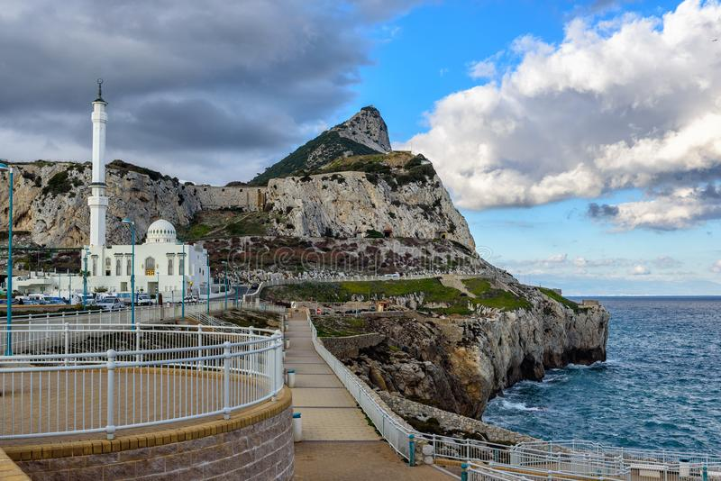 View on rock of Gibraltar and Islam and temple from Europa point at southern part of the city. GIBRALTAR, GREAT BRITAIN - DECEMBER 2017: View on rock of royalty free stock image