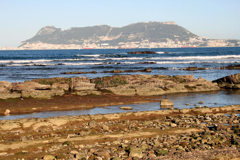 Gibraltar from Punta San Garcia, near Algeciras. A shore view from Punta San Garcia, in the Parque del Centenario, a nature reserve on the outskirts of royalty free stock image