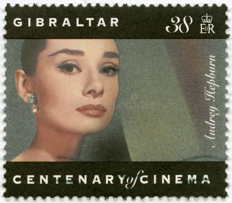 GIBRALTAR - 1995: shows Audrey Hepburn (1929-1993), actress. GIBRALTAR - CIRCA 1995: A stamp printed in Gibraltar shows Audrey Hepburn (1929-1993), actress royalty free stock photo
