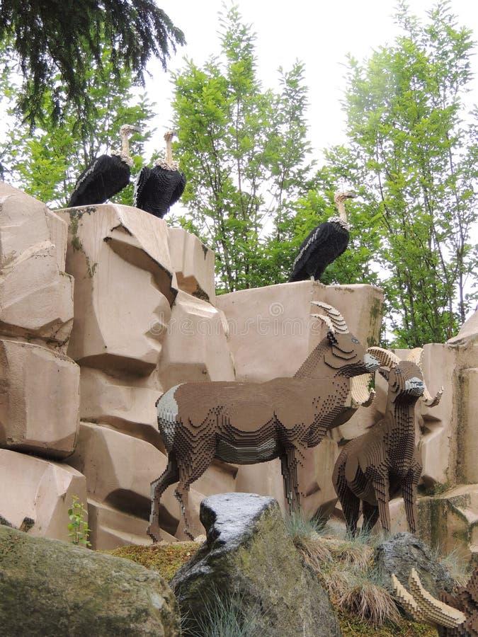 Gieren, gemzen en geiten, door LEGO stock foto's