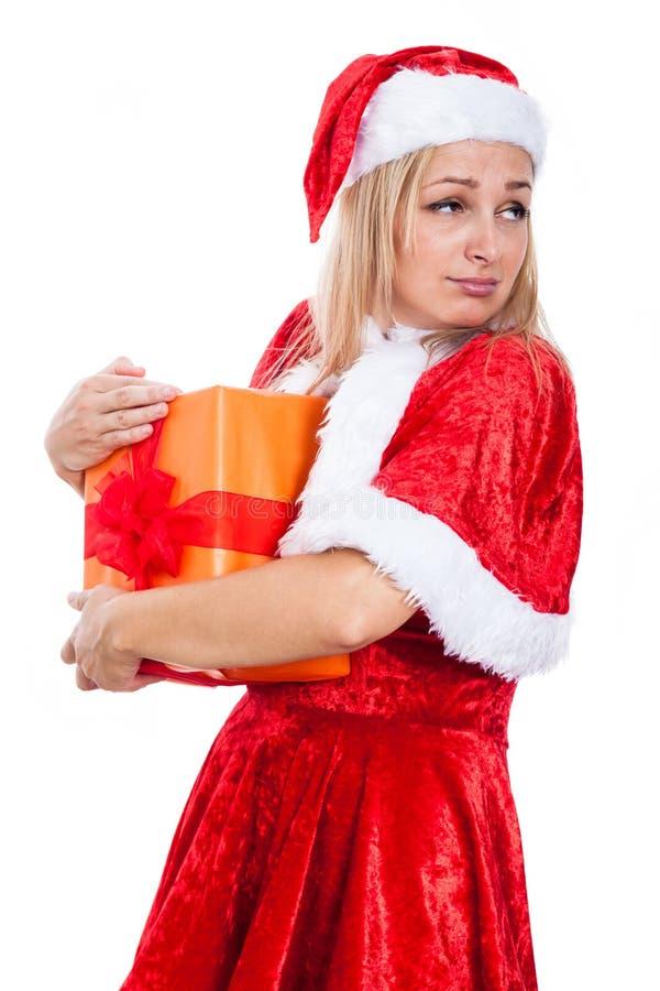 Gierige Weihnachtsfrau stockfoto