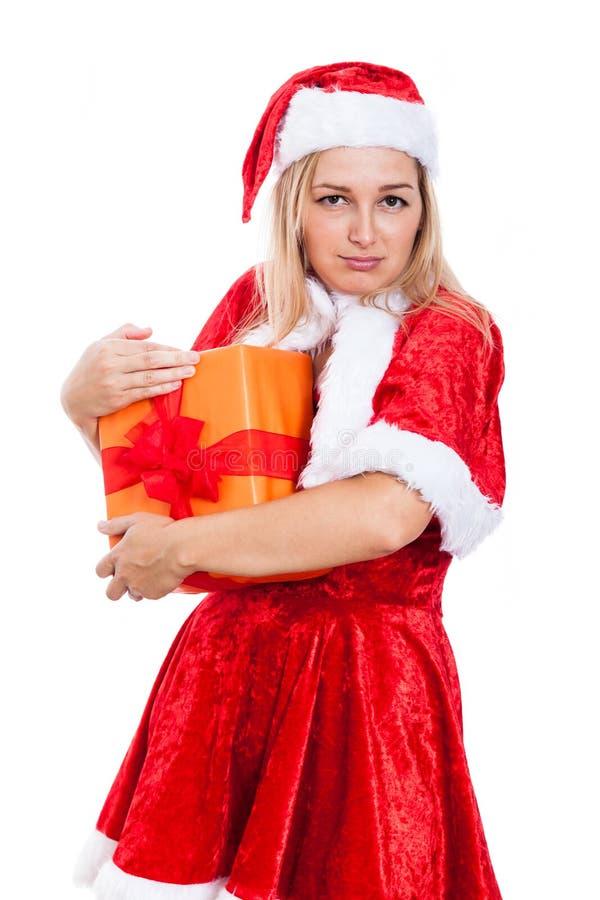Gierige Weihnachtsfrau mit Geschenk lizenzfreies stockbild