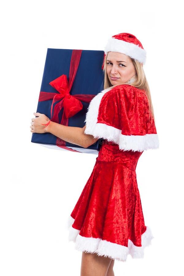 Gierige Weihnachtsfrau mit großem Geschenk lizenzfreies stockfoto