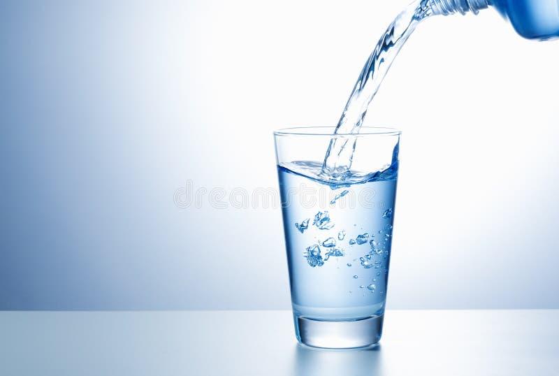 Gietend water stock fotografie