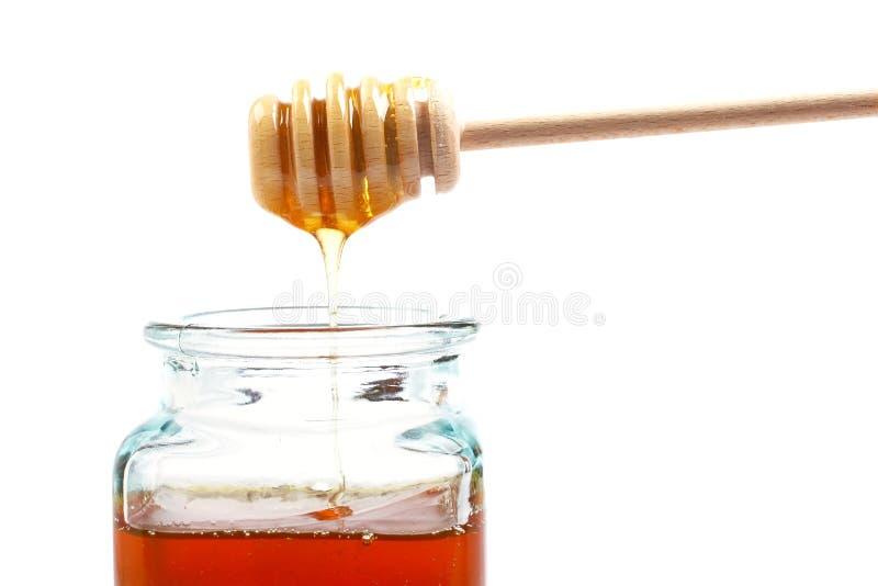 Gietende honing stock foto's