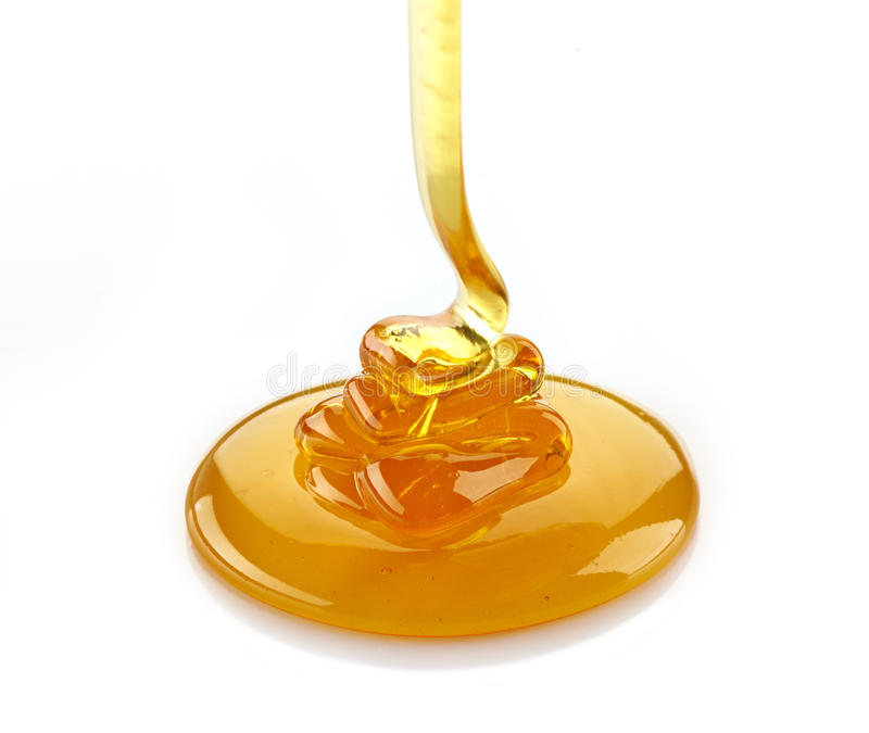 Gietende honing royalty-vrije stock afbeeldingen