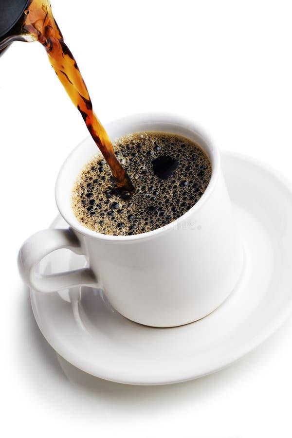 Gietende koffie stock afbeeldingen