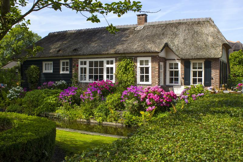 Giethoorn In Netherlands. Giethoorn, Netherlands -typical dutch county side of houses and gardens royalty free stock photo