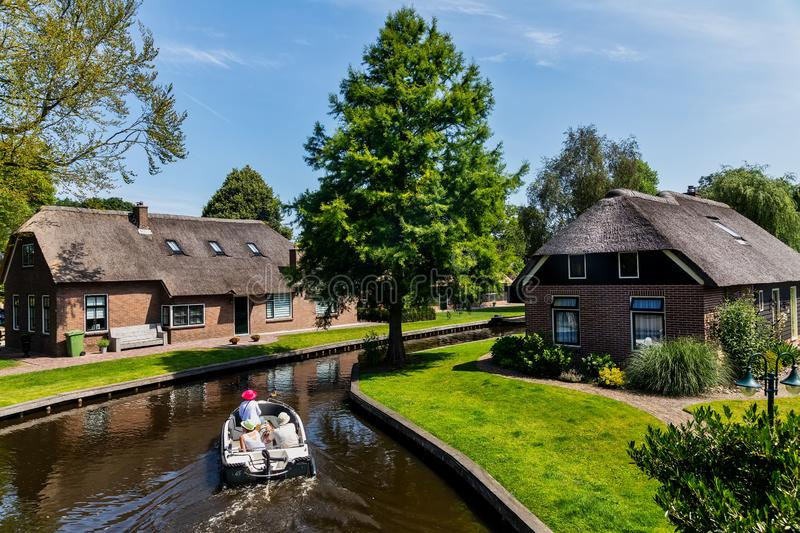 View of famous village Giethoorn with canals in the Netherland. Giethoorn, Netherlands - July 4, 2018: view of famous village Giethoorn with canals in the stock images