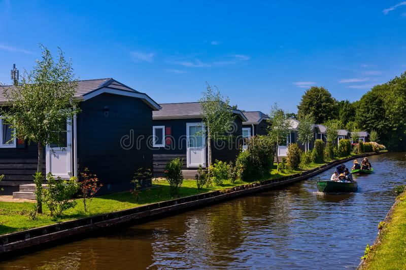 View of famous village Giethoorn with canals in the Netherland. Giethoorn, Netherlands - July 4, 2018: view of famous village Giethoorn with canals in the stock image