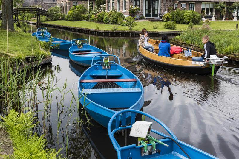 Blue Electric Punter Boats Giethoorn. Giethoorn, The Netherlands - May 19., 2016: Blue Punter Boats in the small, picturesque town of Giethoorn and Chinese stock photography