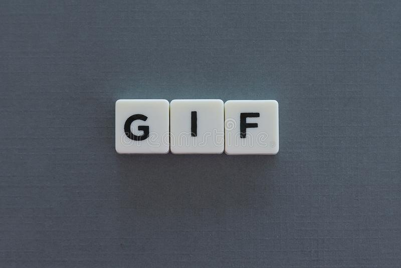 GIF word made of square letter word on grey background. Digital communication computer technology images processing static file format animation interchange stock photography