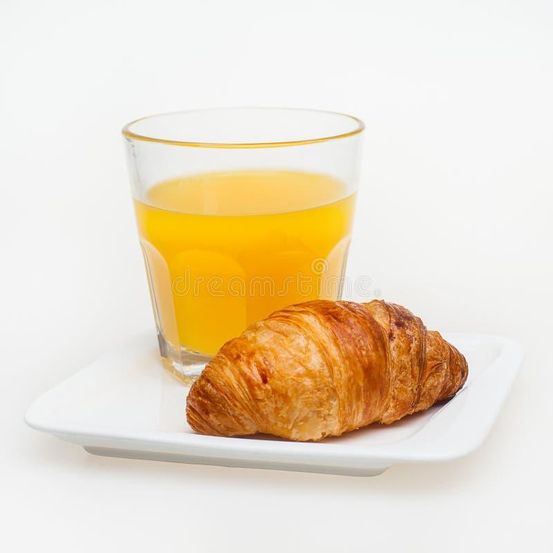 Giffel och orange fruktsaft, smaklig frukost arkivbild