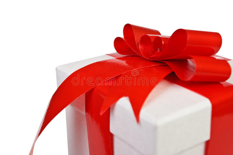 Gift. Beautiful white present gift box with red ribbon royalty free stock photos