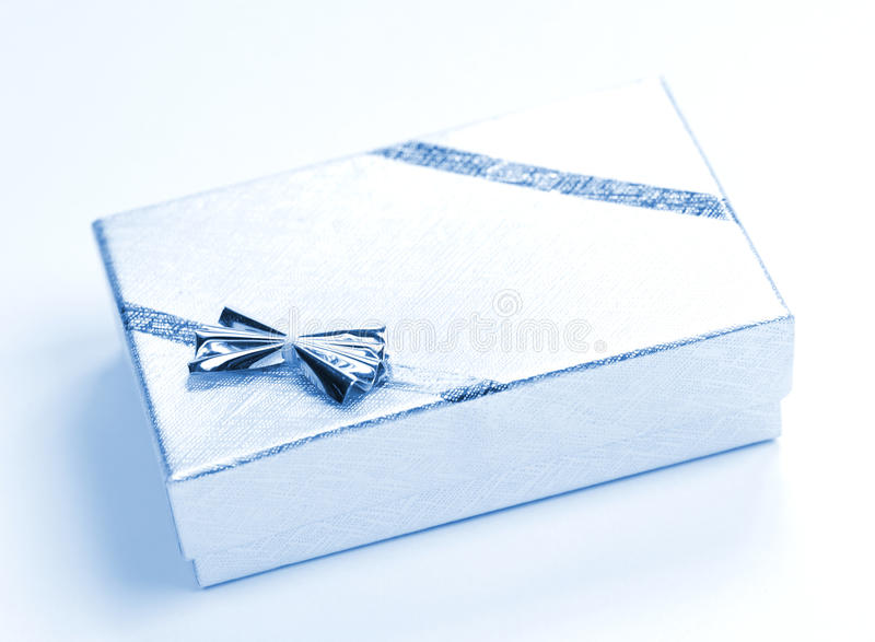 Gift. Small silver gift close up stock photography