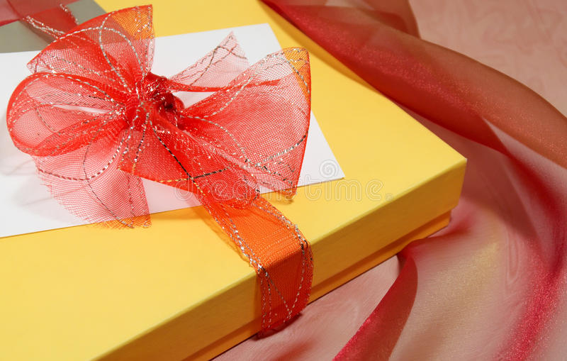 Gift. Box tied with a red bow stock image