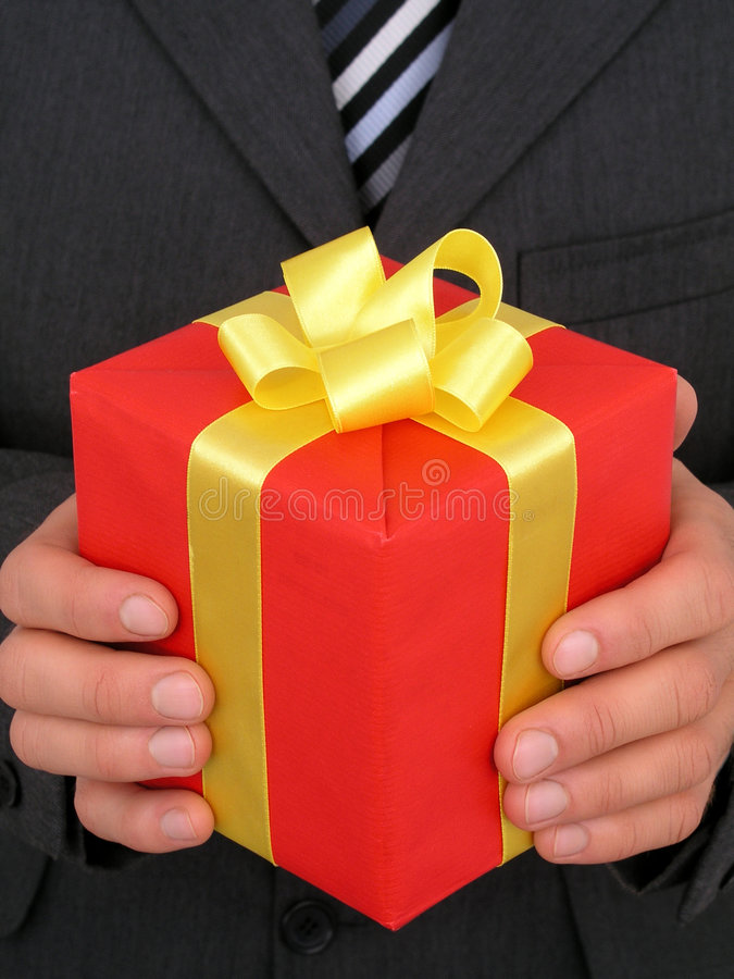 Gift. Businessman Holding Gift