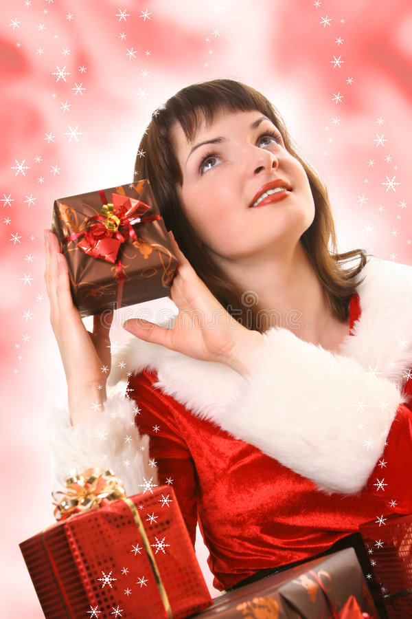 Gift. Young Santa-girl with presents royalty free stock photos