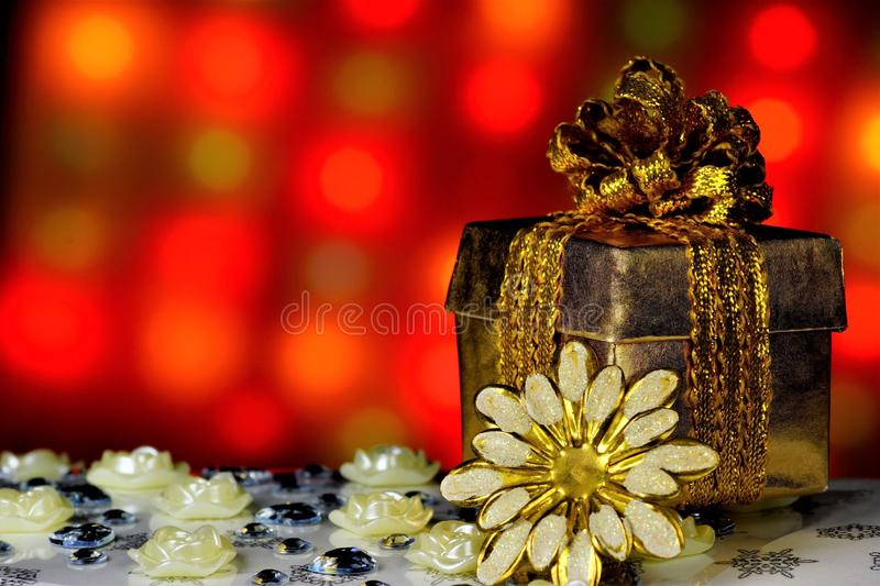 Gift on the background of bright Christmas lights. Fun celebrating important events, give loved ones and dear people gifts and. Flowers stock image