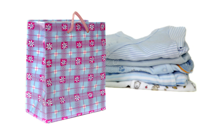Gift Bag and Blue Baby Clothes stock images