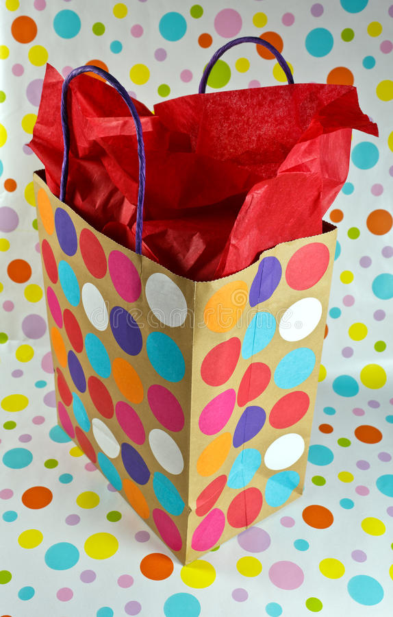 Gift bag with polka dots. On a polka dot backbround stock photography