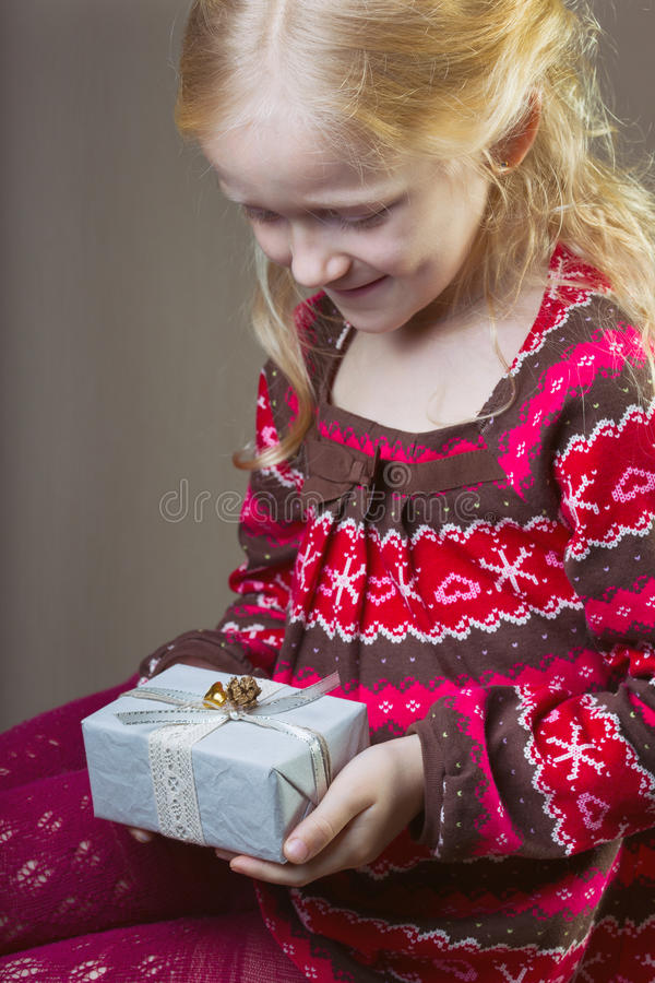 Gift. Beautiful laughing girl holding presents in hands royalty free stock photo