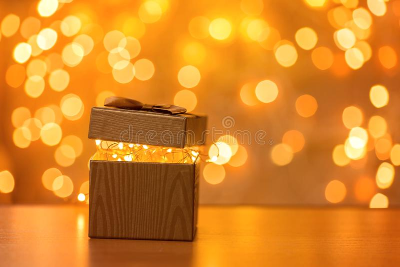 Gift on blurry New Year lights background stock photography