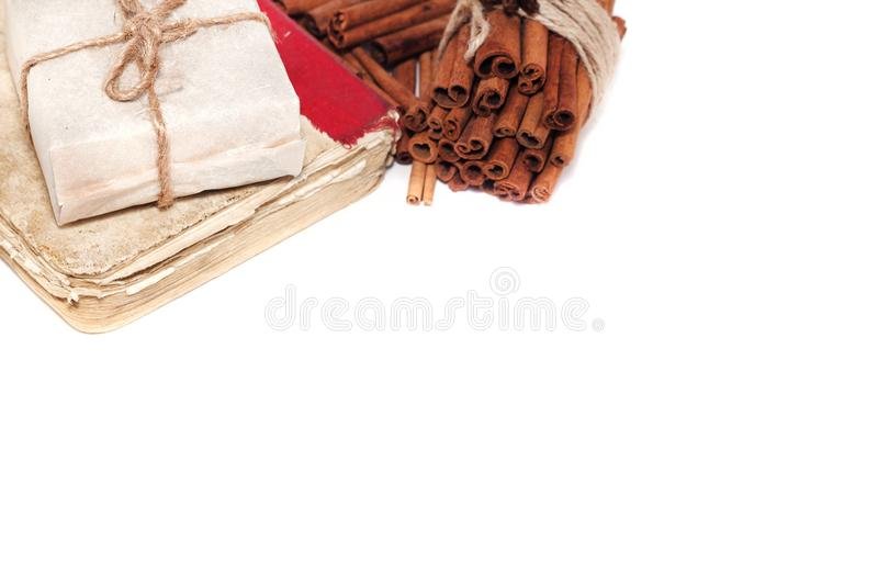 Gift, book and cinnamon set on artistic copy space background . stock image