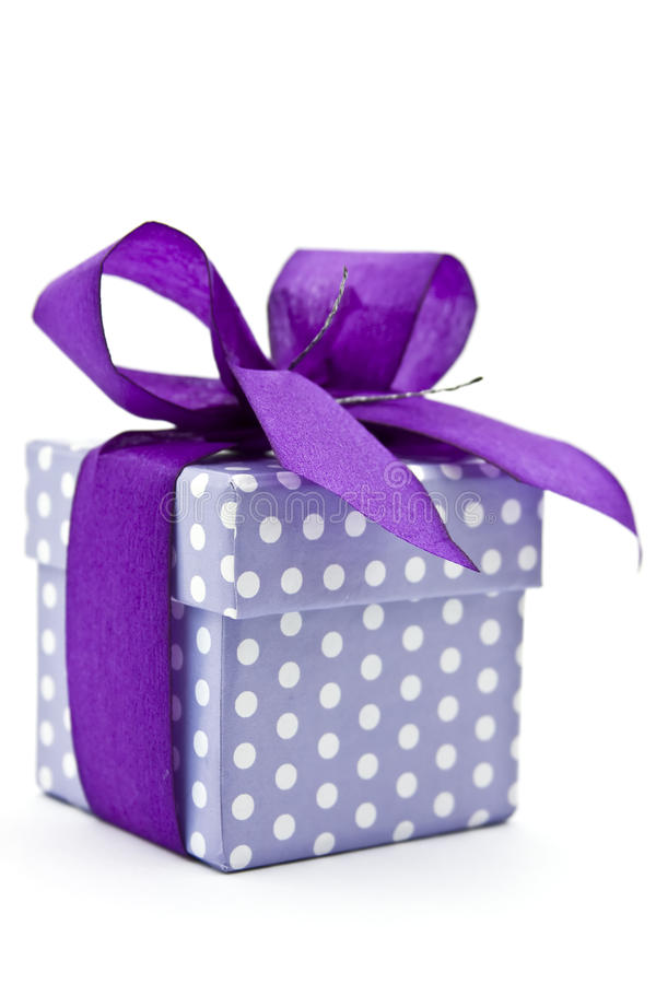 Gift box. With purple bow, whte background royalty free stock photography