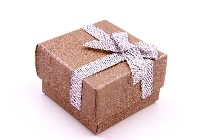 Gift Box. Orange Gift Box with shiny silver ribbons royalty free stock photography