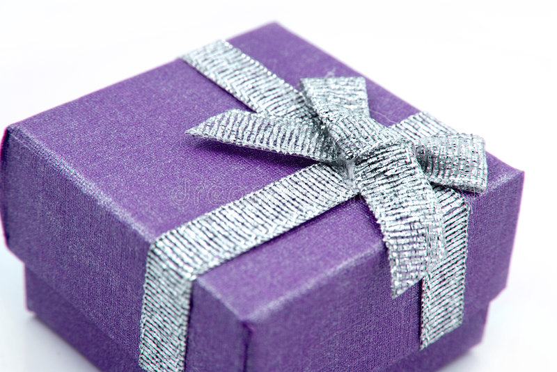 Gift Box. Purple Gift Box with shiny silver ribbon stock images