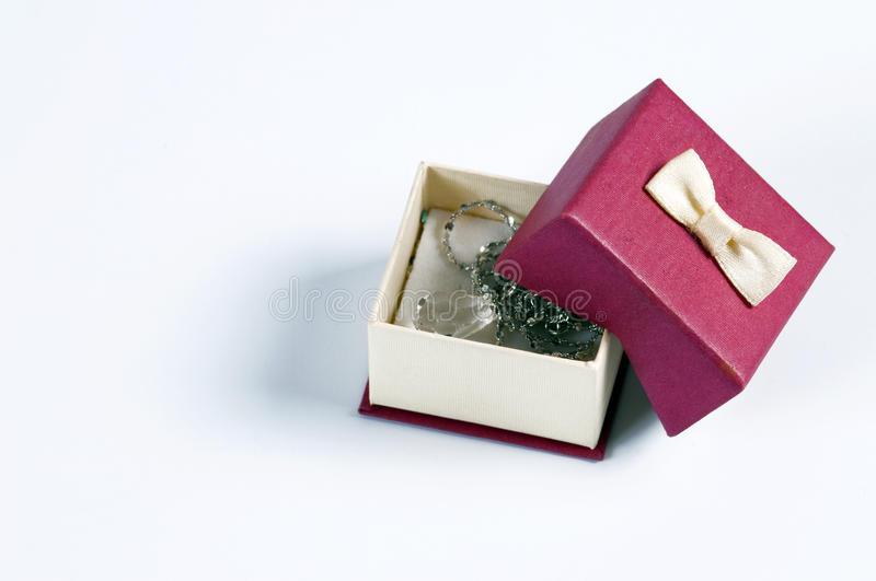 Gift box. A small gift box open to isolate white background royalty free stock photography