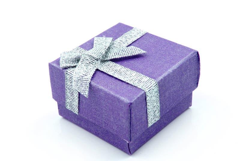 Gift Box. Blue Gift Box with shiny silver ribbons royalty free stock image