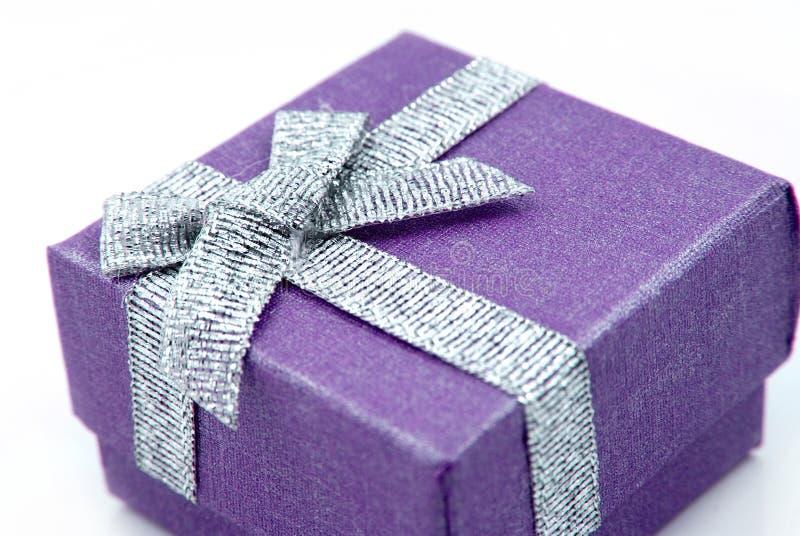 Gift Box. Purple Gift Box with shiny silver ribbon royalty free stock photos