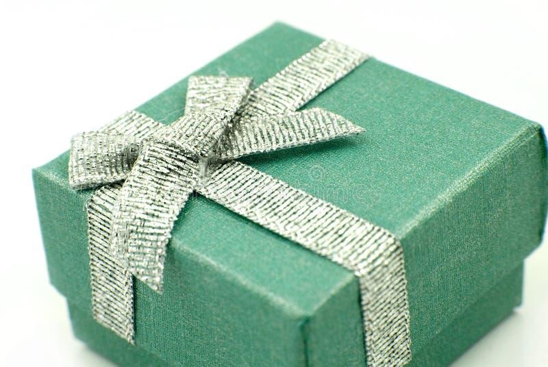 Gift Box. Green Gift Box with shiny silver ribbon stock photo