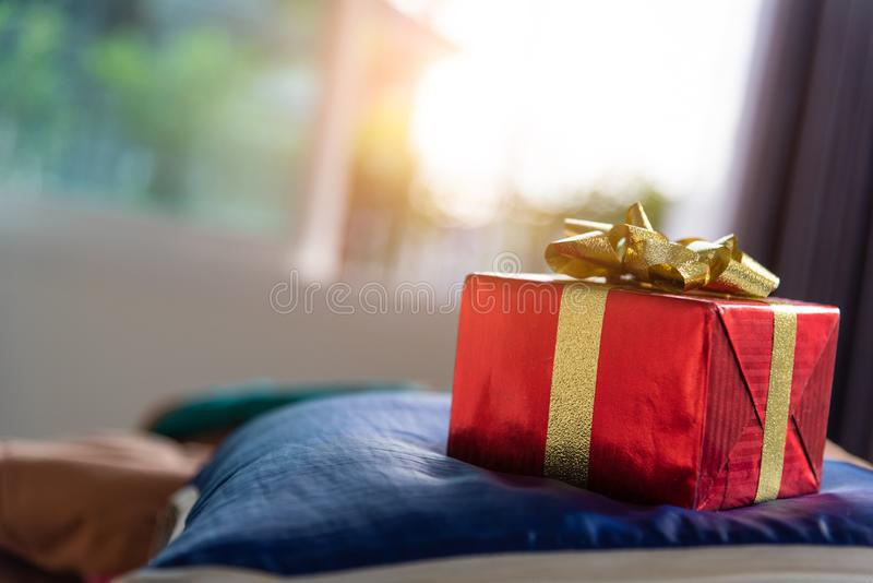 Gift box in bedroom. Holiday and anniversary day concept. Birthday and Valentines day surprise concept. Chirstmas and New year royalty free stock photography