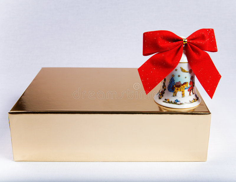 Gift box with bell royalty free stock image