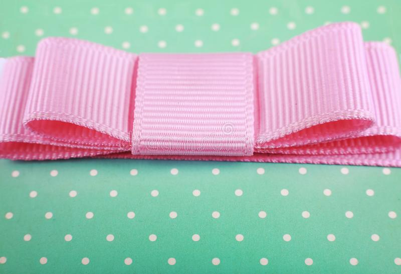Gift, box, birthday, holiday, pink, bow, ribbon, christmas, anniversary, celebration,. Close-up of a pink bow on a gift box. happy Birthday. christmas royalty free stock photography