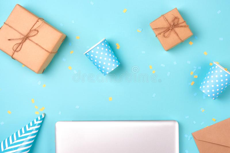 Gift box and birthday party things on a blue background stock photos