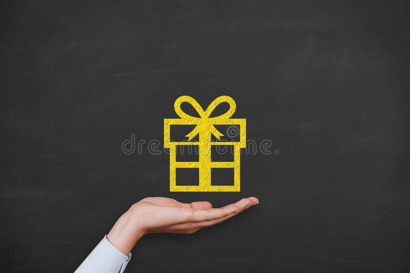 Gift Box on Blackboard Background New Year Concepts stock photos