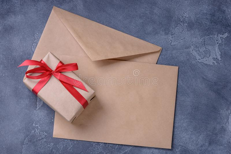 Gift box and blank two brown envelope royalty free stock photos